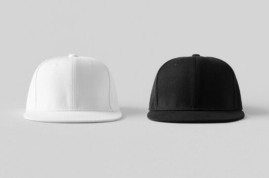 White and black snapback caps mockup on a grey background, front view.