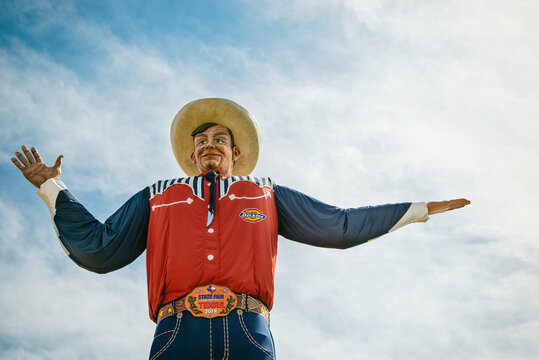 Closeup of the Big Tex statue. The figure icon greets and waves his hands to welcome visitors at the State Fair of Texas fairgrounds on October 17, 2019 in Dallas, Texas.