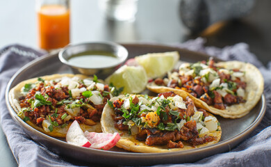 Wall Mural - trio mexican carne asada tacos in corn tortilla on plate