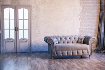 Fototapeta sofa chester on a background of gray wall obraz