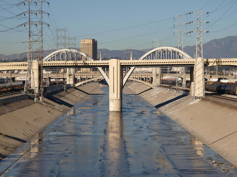 View of the Los Angeles river and old 6th street bridge in Southern California.  Bridge was torn down and replaced in 2019.
