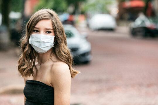 Teen Girl Wearing Face Mask Walking On A Public Street
