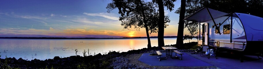 Travel trailer camping by the Mississippi river at sunset in Thomson Causway Illinois