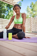 athletic african american woman in sportswear promoting health products ,