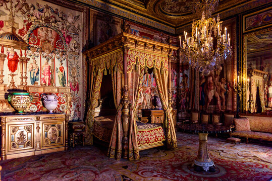 SEINE-ET-MARNE, FRANCE - MARCH 31, 2018: Royal bedroom in the Palace of Fontainebleau, one of the largest French royal castles. UNESCO World Heritage Site.