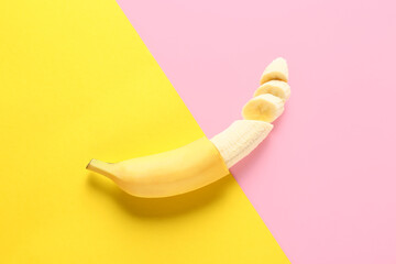 Ripe cut banana on color background