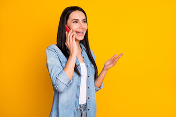 Photo of pretty mature lady calling to her best girlfriend isolated on bright yellow background