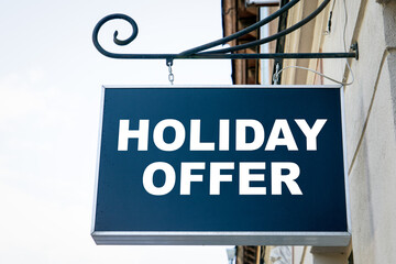 HOLIDAY OFFER. Shop, cafe, restaurant or hotel signboard. City center and old town