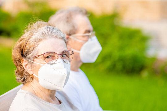 Portrait  of a senior couple wearing protective masks during the coronavirus epidemic