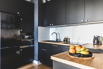 Kitchen in a modern studio apartment for rent. Interior design.