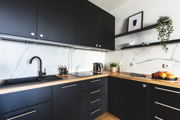 Kitchen in a modern studio apartment for rent. Interior design.