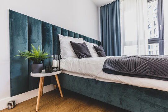Cozy bedroom with comfortable bed in modern studio apartment.