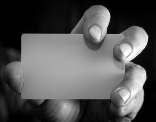 Close up of a plastic card in hand.