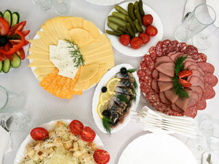 Dishes and fish salads on the festive table