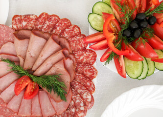 Dishes and salads of sausage and tomatoes