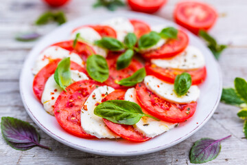 Caprese salad with tomatoes and mozzarella. Italian food.