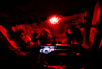 Actors dressed as zombies or ghouls perform during  a drive-in haunted house show, perfromed by Kowagarasetai, for people inside a car in order to maintain social distancing amid the spread of the coronavirus disease (COV
