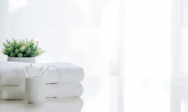 Clean white towel on white table, copy space.