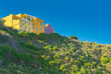 View on mountain and colorful buildings on the top in Punta Brava, Puerto de la Cruz, Tenerife, Canary Islands, Spain