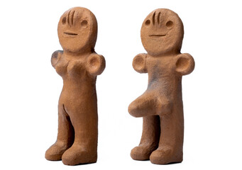 Ancient clay male and female figurines from Canary Islands isolated on white background
