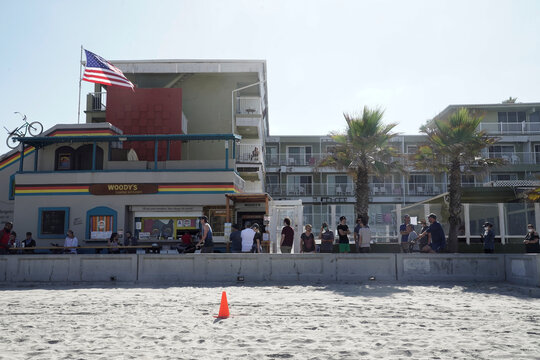 People crowd San Diego beaches ahead of the Fourth of July weekend, in San Diego