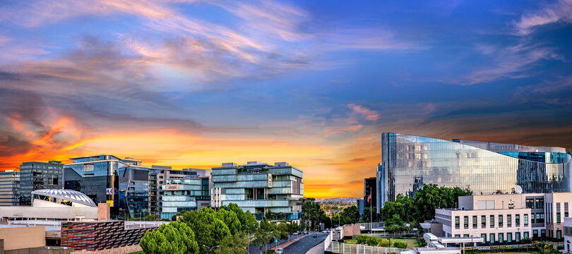 Panorama of Sandton City at sunset with colourful clouds