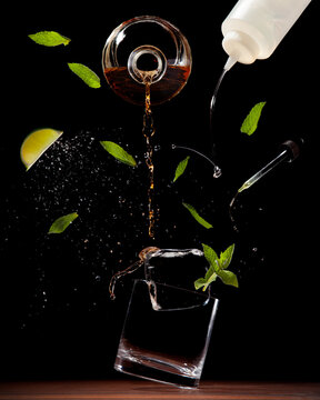 Exploded view of a cocktail on a dark background