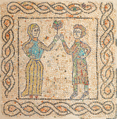 RAVENNA, ITALY - JANUARY 29, 2020: The detail (man and woman with the flower) of early christian mosaic pavement from elder builidng in the Chiesa di San Giovanni Evangelista church.
