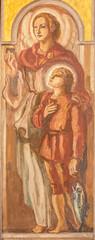 BARCELONA, SPAIN - MARCH 3, 2020: The fresco of archangel Raphael with the Tobiac in the church Parroquia Santa Teresa de l'Infant Jesus by Francisco Labarta (20. cent.).