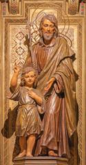 BARCELONA, SPAIN - MARCH 3, 2020: The carved polychrome statue of St. Joseph of Pauda in the church Iglesia Santa Maria de Gracia de Jesus.