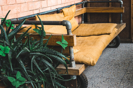 old recycled furniture, eco-friendly manufactory, mattress sits and pillows on the sofa made of recycled coffee sacs and bags