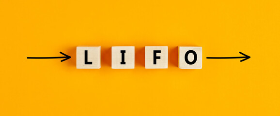 The business abbreviation lifo (last in first out) written on wooden blocks with directional arrows