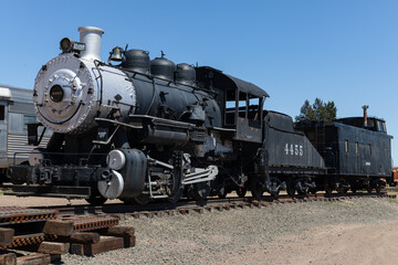 Early twentieth century  steam locomotive  with tender and caboose.