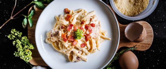 Pasta Carbonara in white dish, with fresh ingredient