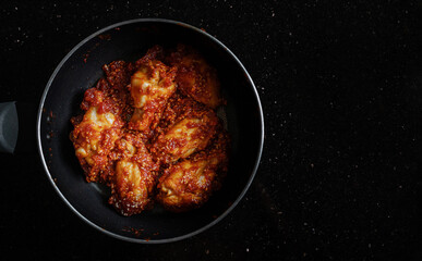 Spicy fried chicken, Korean style, in frying pan