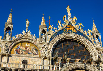 Fototapete - St Mark`s Basilica or San Marco close-up, Venice, Italy. It is top landmark in Venice. Beautiful ornate exterior of medieval basilica, detail of luxury facade