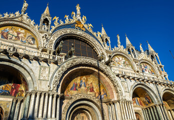 Fototapete - St Mark`s Basilica or San Marco, Venice, Italy. It is top landmark in Venice. Beautiful ornate portals of medieval basilica