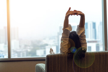 Relax happy business woman lifestyle at home sitting in hotel bedroom looking out of window : Easy happy people. Simplify Your Life Week