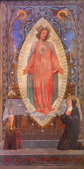 BARCELONA, SPAIN - MARCH 3, 2020: The painting of traditional Divine Mercy of Jesus the chruch glesia y convento de las Salesas by Enric Monserdà i Vidal (1850-1926)