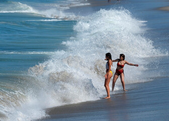 People play in the water during the outbreak of the coronavirus disease (COVID-19) at Venice Beach in Los Angeles