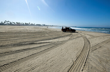 A Los Angeles County Fire Department lifeguard truck sits on a closed beach during the outbreak of the coronavirus disease (COVID-19) at Venice Beach in Los Angeles