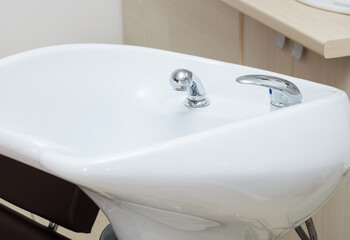 white sink in modern hairdressing salon