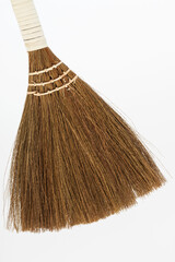 new broom on white background