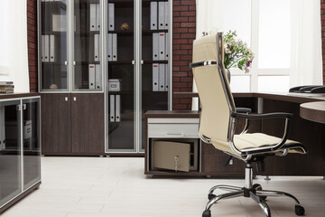 workplace with safe in modern office