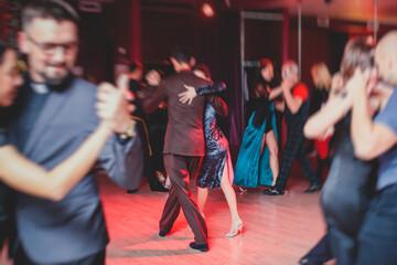 Printed kitchen splashbacks Dance School Couples dancing argentinian dance milonga in the ballroom, tango lesson in the red lights, dance festival