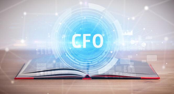 Open book with CFO abbreviation, modern technology concept