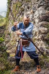 Viking warrior brandishes an ax in a threatening way
