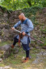 Viking warrior draws his sword