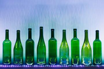 abstract empty wine bottles with blue led illumination
