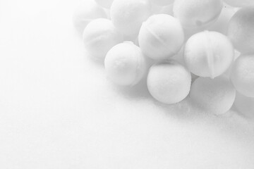 many snowballs on white snow background with copy-space